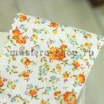 Ткань для печворка и рукоделия Мелкие оранжевые цветы