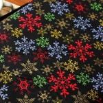 Ткань для печворка и рукоделия Цветные снежинки на черном